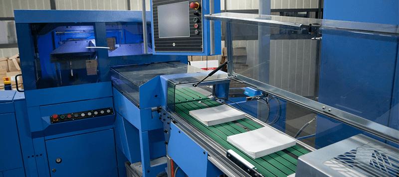 Máquina de corte trilateral Müller Martini en Tubookdigital